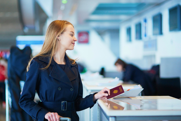 woman with passport at airport