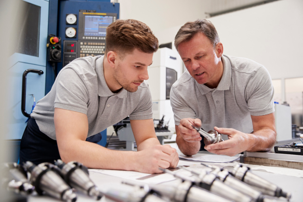 engineers looking at parts